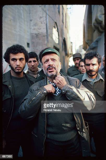 Yasser Arafat adjusts his cravat December 19 1983 in Tripoli Lebanon After receiving the Nobel Peace Prize in 1994 Palestine Liberation Organization...