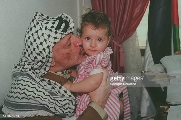 Yasser Arafat and his daughter Zahwa in Arafat's Gaza City office