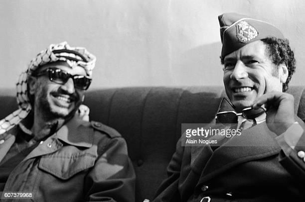 Yasser Arafat of the Palestine Liberation Organization and Muammar alQaddafi of Libya join Arab political leaders from Algeria Syria and South Yemen...