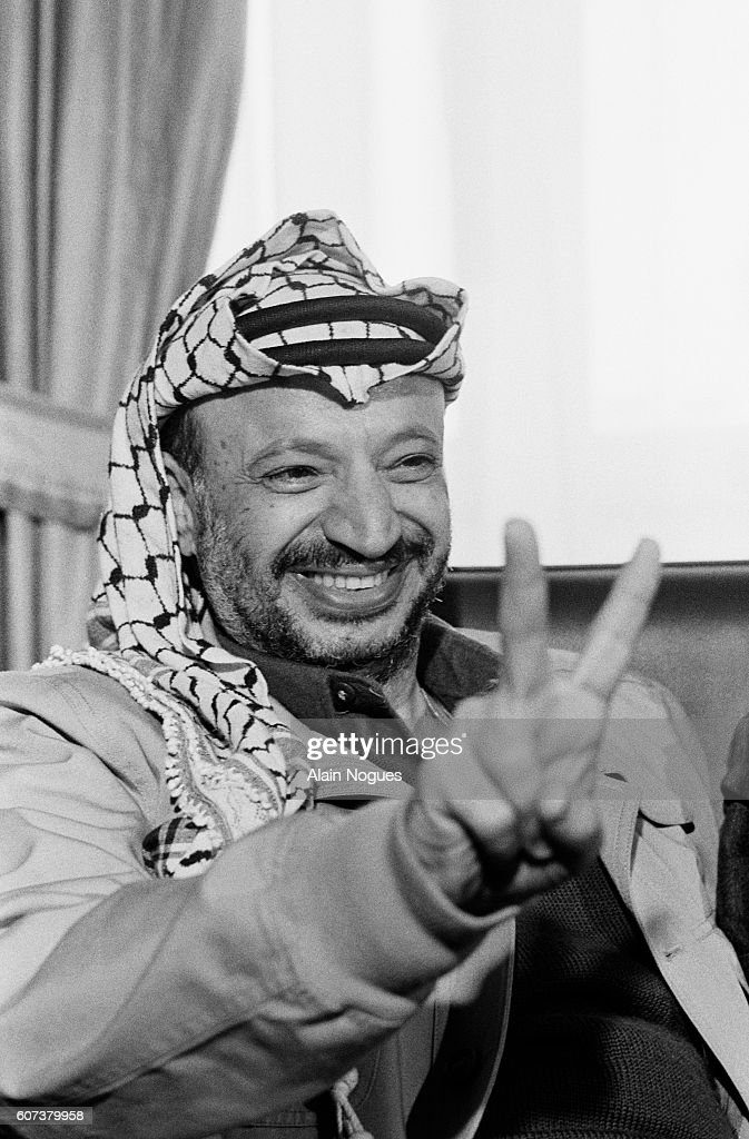 Image result for 1988 – PLO Chairman Yasser Arafat gives a speech at a UN General Assembly meeting in Geneva, Switzerland,