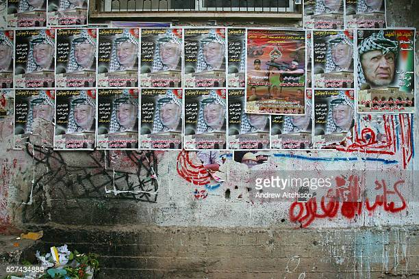Yasser Arafat posters after his death on the wall of a building in the Balata refugee camp in Nablus West Bank Palestine