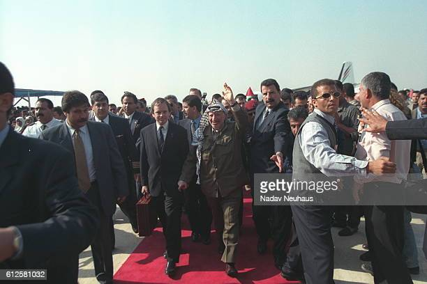 Yasser Arafat, president of the Palestinian Authority, arrives.