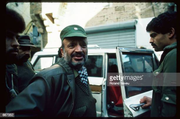 Yasser Arafat speaks before entering a vehicle December 19 1983 in Tripoli Lebanon After receiving the Nobel Peace Prize in 1994 Palestine Liberation...