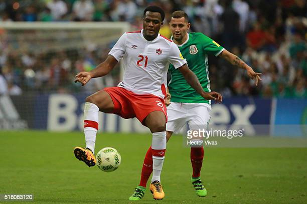 Yasser Corona of Mexico struggles for the ball with Cyle Larin of Canada during the match between Mexico and Canada as part of the FIFA 2018 World...