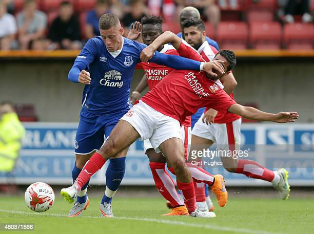 Yasser Kasim of Swindon Town tackles Ross Barkley of Everton during the Pre Season Friendly match between Swindon Town and Everton at the County...