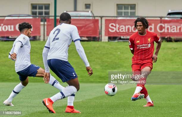 Yasser Larouci of Liverpool and Jubril Okedina of Tottenham Hotspur in action during the PL2 game at The Kirkby Academy on August 10 2019 in Kirkby...