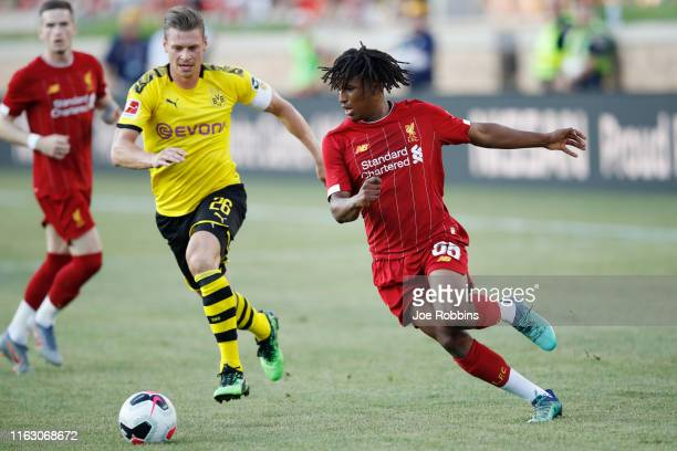 Yasser Larouci of Liverpool FC controls the ball against Lukasz Piszczek of Borussia Dortmund in the first half of the preseason friendly match...