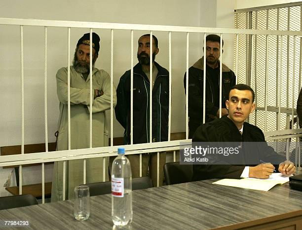 Yasser Zanon Sami Hamoda and Hani Mousa stand in the cage next to their lawyer Shadi AlKordi in the military court November 19 2007 in Gaza City Gaza...