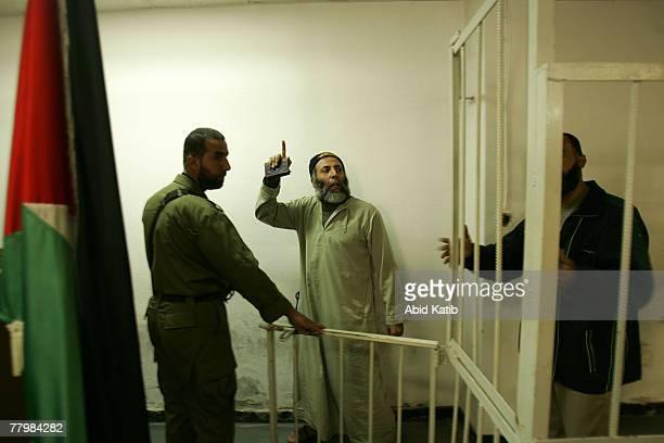 Yasser Zanon shouts as he stand next to Sami Hamoda and Hani Mousa in the military court November 19 2007 in Gaza City Gaza Strip The Three...