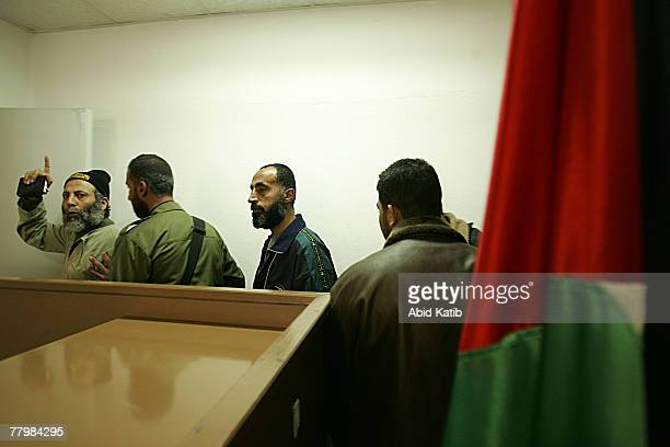 Yasser Zanon shouts as he stand next to Sami Hamoda and in the military court November 19 2007 in Gaza City Gaza Strip The Three Palestinian security...