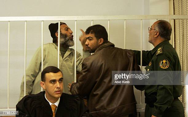 Yasser Zanon talks to the head of the military court Amen Nofal next to his lawyer Shadi AlKordi in the military court November 19 2007 in Gaza City...