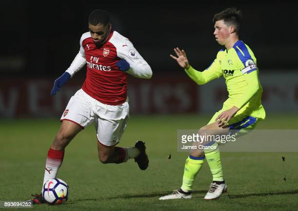 Yassin Fortune of Arsenal attempts to get away from Charles Vernam of Derby during the Premier League 2 match between Arsenal and Derby County at...