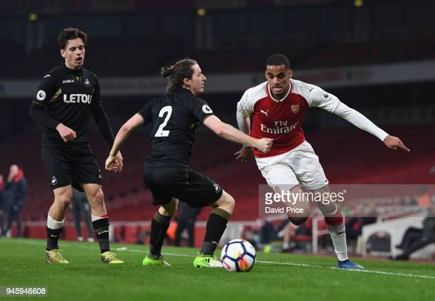 Yassin Fortune of Arsenal takes on Aaron Lewis of Swansea during the match between Arsenal U23 and Swansea U23 at Emirates Stadium on April 13 2018...