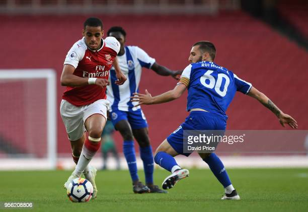 Yassin Fortune of Arsenal takes on Rui Moreira of Porto during the match between Arsenal and FC Porto at Emirates Stadium on May 8 2018 in London...