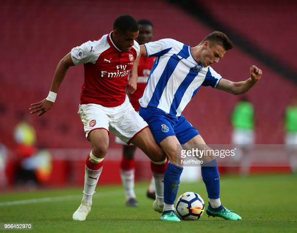 Yassin Fortune of Arsenal U23s holds of Oleg Reabciuk of Porto FC during Premier League International Cup Final match between Arsenal Under 23...