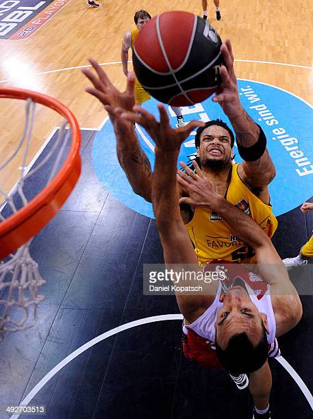 Yassin Idbihi of Muenchen is challenged by Gary McGhee of Ludwigsburg during the Beko BBL Playoffs semifinal match between MHP RIESEN Ludwigsburg and...