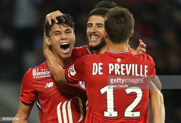 Yassine Benzia of Lille celebrates his goal with Luiz Araujo and Nicolas De Preville during the preseason friendly match between Lille OSC and Stade...