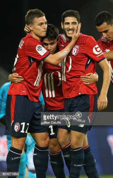 Yassine Benzia of Lille celebrates his goal with Nicolas De Preville Luiz Araujo during the preseason friendly match between Lille OSC and Stade...