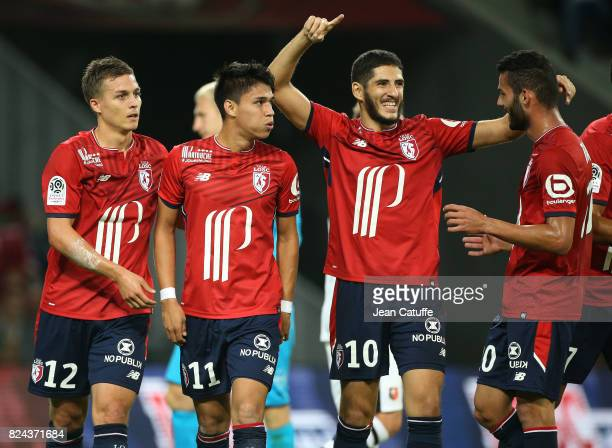 Yassine Benzia of Lille celebrates his goal with Nicolas De Preville Luiz Araujo Thiago Maia during the preseason friendly match between Lille OSC...