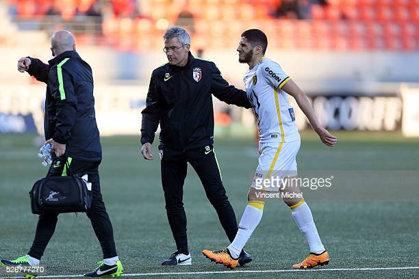 Yassine Benzia of Lille is injured during the French Ligue 1 match between Fc Lorient and Lille OSC at Stade du Moustoir on April 30 2016 in Lorient...