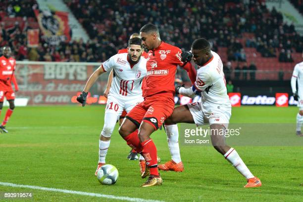 Yassine Benzia of Lille Wesley Said of Dijon and Amadou Ibrahim of Lille during the Ligue 1 match between Dijon FCO and Lille OSC at Stade Gaston...