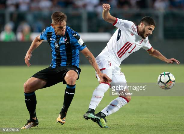Yassine Benzia of LOSC Lille competes for the ball with Rafael Toloi of Atalanta BC during the preseason friendly match between Atalanta BC and LOSC...