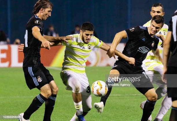 Yassine Benziae of Fenerbahce in action against Ivan Saulic and Amer Gojak of Dinamo Zagreb during UEFA Europa League Group D match between Dinamo...
