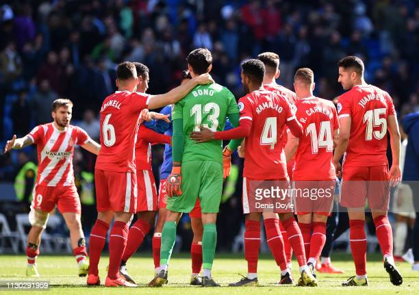 Yassine 'Bono' Bounou of Girona celebrates with teammates following the La Liga match between Real Madrid CF and Girona FC at Estadio Santiago...