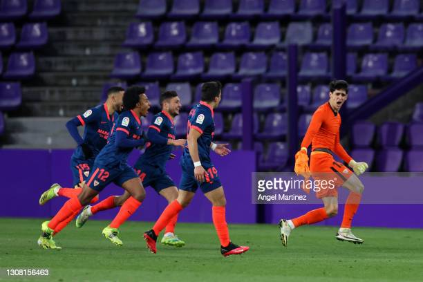 Yassine Bounou of Sevilla FC celebrates with teammates after scoring their team's first goal during the La Liga Santander match between Real...