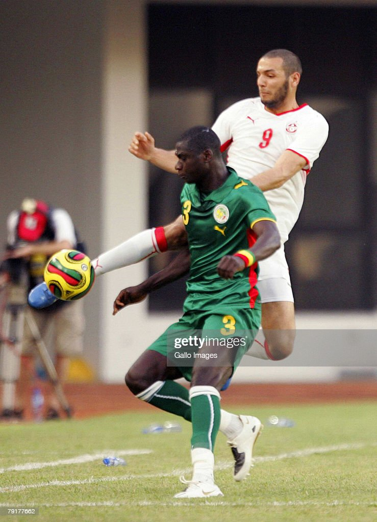 TAMALE, GHANA - JANUARY 23, Yassine Chikaoui of Tunisia and Ndaw Guirane of Senegal during the Group D AFCON match between Tunisia and Senegal held at the Tamale Stadium on January 23, 2008 in Tamale, Ghana.