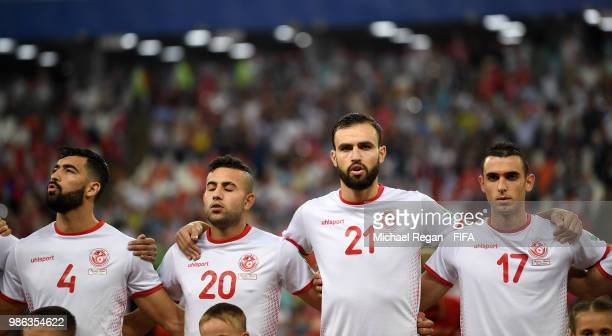 Yassine Meriah Ghaylen Chaaleli Hamdi Naguez and Ellyes Skhiri of Tunisia line up prior to the 2018 FIFA World Cup Russia group G match between...