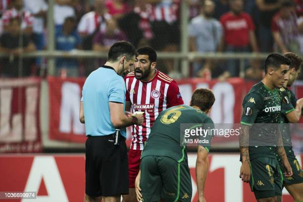 Yassine Meriah of Olympiacos argues with referee during the UEFA Europa League Group F match between Olympiacos and Real Betis at Karaiskakis Stadium...