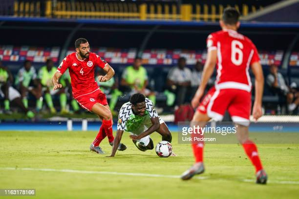 Yassine Meriah of Tunisia and Temitayo olufisayo olaoluwa Aina of Nigeria during the 3rd place African Nations Cup match between Tunisia and Nigeria...