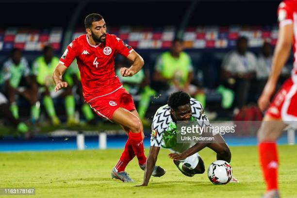 Yassine Meriah of Tunisia and Temitayo olufisayo olaoluwa Aina of Nigeria during the 2019 Africa Cup of Nations third place final soccer match...