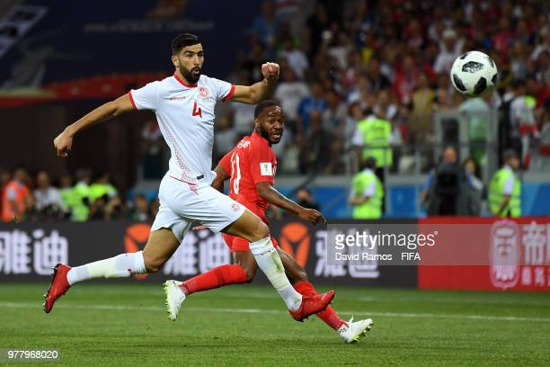 Yassine Meriah of Tunisia challenge for the ball with Raheem Sterling of England during the 2018 FIFA World Cup Russia group G match between Tunisia...