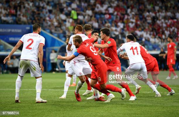 Yassine Meriah of Tunisia clashes with Harry Kane of England in the box during the 2018 FIFA World Cup Russia group G match between Tunisia and...