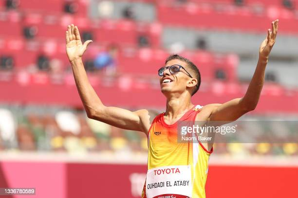 Yassine Ouhdadi El Ataby of Team Spain celebrates after winning gold medal in Men's 5000m - T12 final on day 4 of the Tokyo 2020 Paralympic Games at...