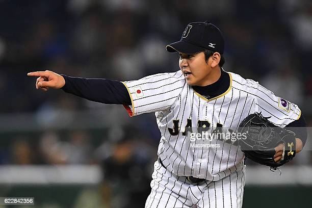 Yasuaki Yamasaki pitches in the eighth inning during the international friendly match between Japan and Netherlands at the Tokyo Dome on November 12,...