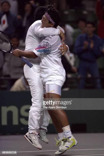 Yasufumi Yamamoto and head coach Tsuyoshi Fukui celebrate after the Davis Cup AsiaOceania Zone Group I Playoff between Japan and China at Ariake...
