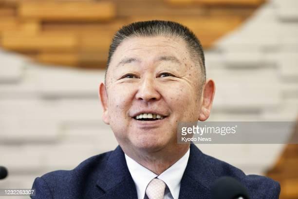Yasuhiko Abe, who coached golfer Hideki Matsuyama during his Tohoku Fukushi University years, smiles at a press conference in Sendai, northeastern...