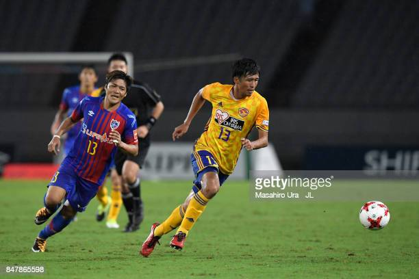 Yasuhiro Hiraoka of Vegalta Sendai controls the ball under pressure of Yoshito Okubo of FC Tokyo during the JLeague J1 match between FC Tokyo and...