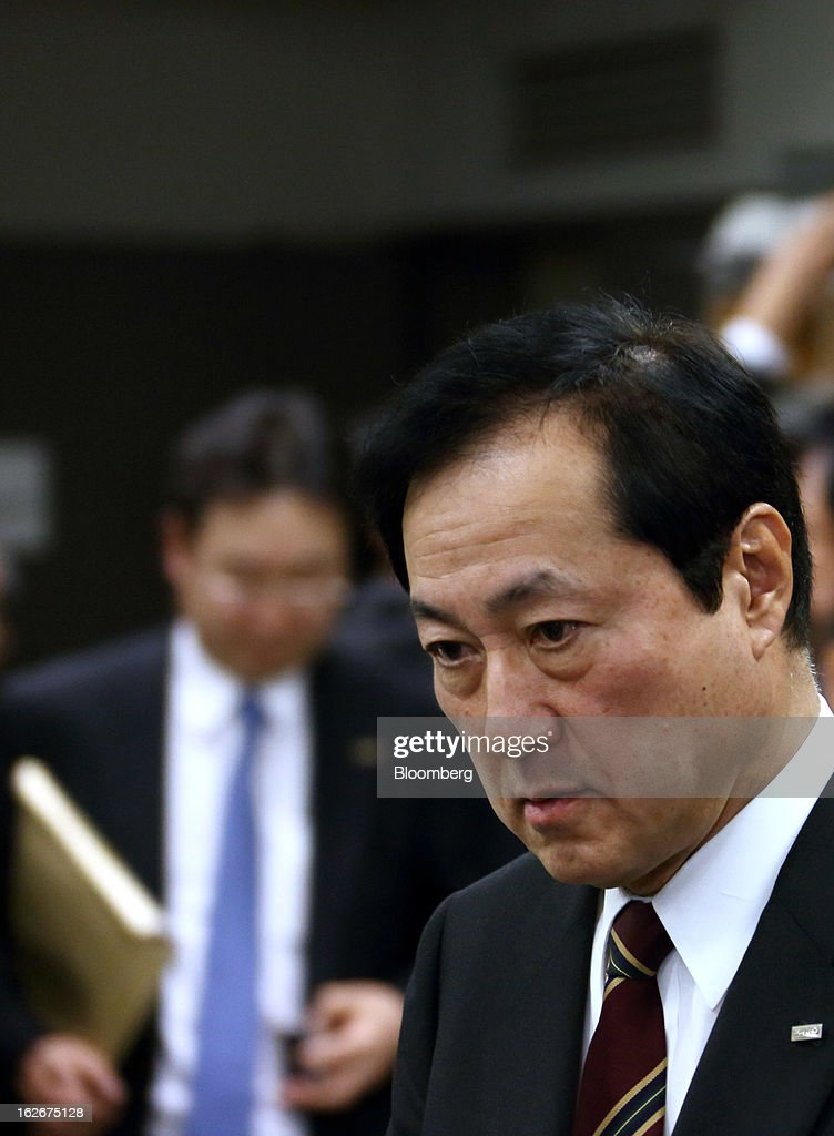 Yasuhiro Sato, president and chief executive officer of Mizuho Financial Group Inc., arrives for a news conference in Tokyo, Japan, on Tuesday, Feb. 26, 2013. Mizuho Financial Group Inc., Japan's third-biggest bank by market value, plans to cut an additional 600 jobs as it targets profit of 550 billion yen ($6 billion) in three years following the merger of its lending units. Photographer: Tomohiro Ohsumi/Bloomberg via Getty Images