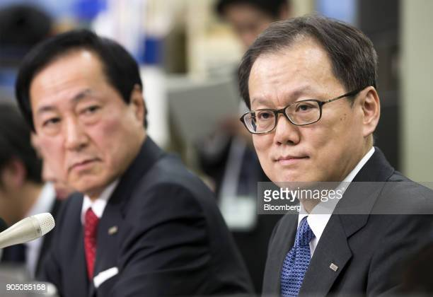 Yasuhiro Sato president and chief executive officer of Mizuho Financial Group Inc left looks at Tatsufumi Sakai president and chief executive officer...