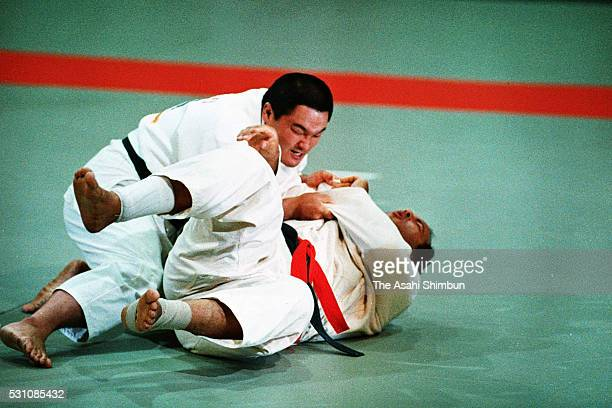 Yasuhiro Yamashita of Japan holds Mohamed Ali Rashwan of Egypt in the Judo Openweight gold medal match during the Los Angeles Summer Olympic Games at...