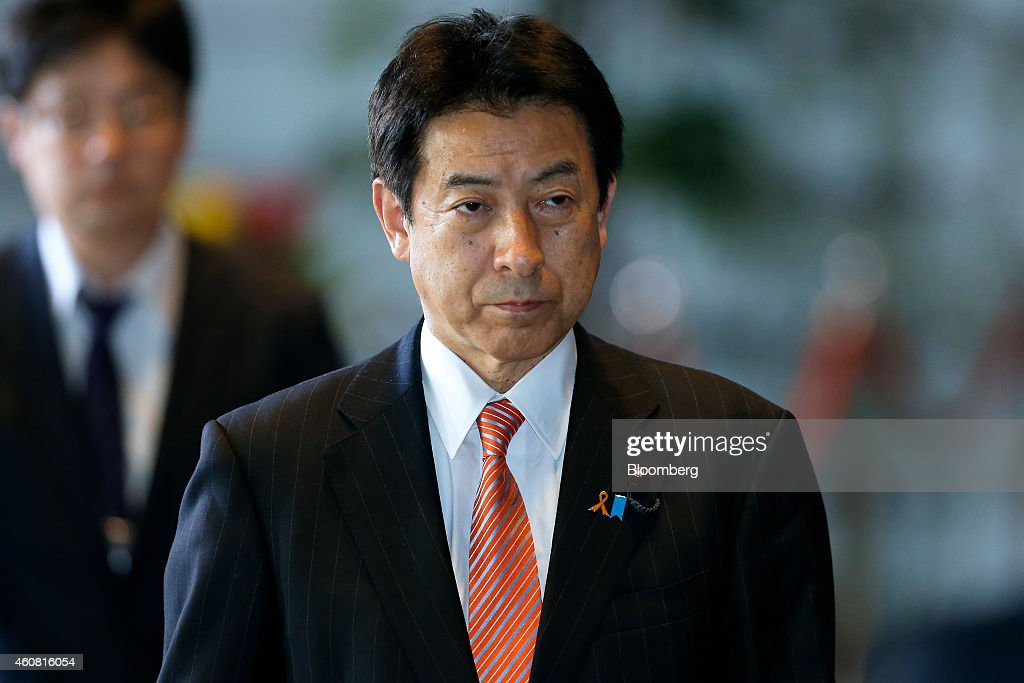 Yasuhisa Shiozaki, Japan's re-appointed health, labor and welfare minister, arrives at the prime minister's official residence in Tokyo, Japan, on Wednesday, Dec. 24, 2014. Japanese Prime Minister Shinzo Abe appointed a former soldier and security veteran as his new defense minister, as he prepares to push through legislation to toughen the country's military stance amid a dispute with China. Photographer: Kiyoshi Ota/Bloomberg via Getty Images