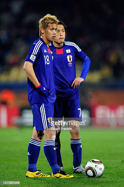 Yasuhito Endo and Keisuke Honda of Japan prepare to take a free kick during the 2010 FIFA World Cup South Africa Group E match between Denmark and...