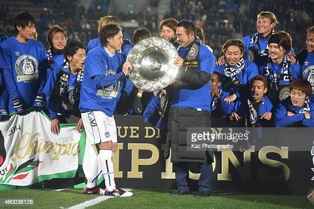 Yasuhito Endo, captain of Gamba Osaka and Kenta Hasegawa, coach of Gamba Osaka hold schale as J1 champion during the J.League match between Tokushima...
