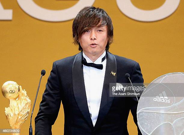 Yasuhito Endo of Gamba Osaka addresses after receiving the Most Valuable Player Award during the 2014 J.League Awards at Yokohama Arena on December...