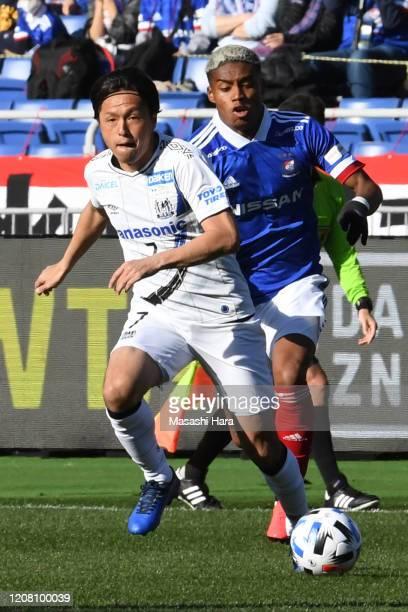 Yasuhito Endo of Gamba Osaka and Ado Onaiwu of Yokohama F.Marinos compete for the ball during the J.League MEIJI YASUDA J1 match between Yokohama...