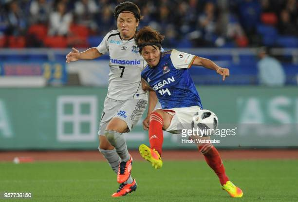 Yasuhito Endo of Gamba Osaka and Jun Amano of Yokohama FMarinos compete for the ball during the JLeague J1 match between Yokohama FMarinos and Gamba...